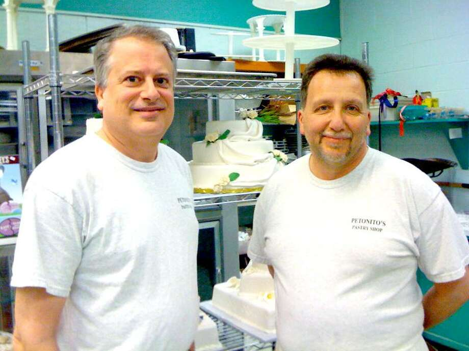 Ann DeMatteo/Register photo: Petonito's Pastry Shop in East Haven is a small business that pays for paid sick days for its full-time employees. At left is Mark Petonito with one of his longtime bakers, Mark Severino.
