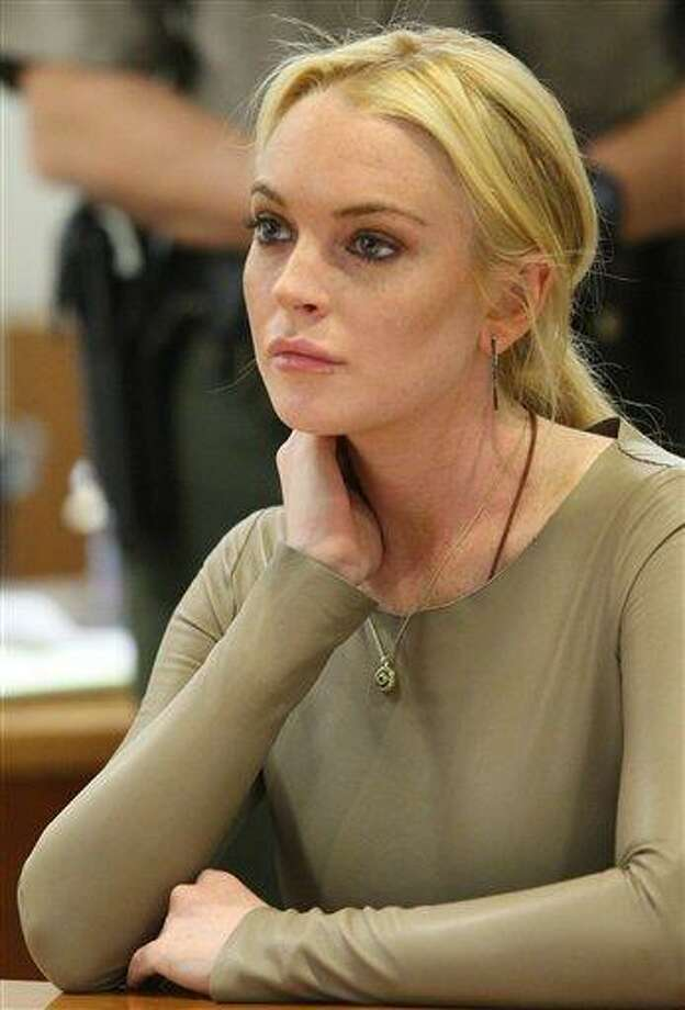 Lindsay Lohan appears at Los Angeles Superior Court, Thursday, March 10, 2011. Lohan rejected a plea agreement Thursday offered by prosecutors in a grand theft case that included a guaranteed return to jail. She told a judge she agreed to delaying her case until a preliminary hearing when prosecutors will present evidence against her. Lohan is accused of taking a $2,500 necklace from a Venice jewelry store. (AP Photo/David McNew, pool) Photo: ASSOCIATED PRESS / AP2011