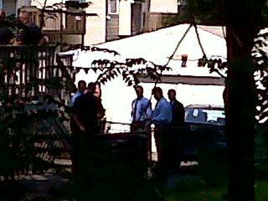 Authorities at the scene of a backyard pool accident in New Haven Monday. (William Kaempffer/Register)
