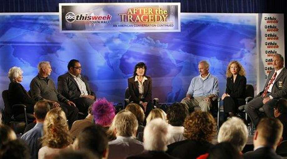 """In this photo released by ABC-TV, ABC News correspondent Christiane Amanpour, center, leads a town hall event at the St. Odilia Church in Tucson, Ariz., during a taping of """"This Week"""" with Chistiane Amanpour on Saturday, Jan. 15, 2011. The event brought together members of the community and residents who were involved in the shooting in Tucson on Jan. 8, which claimed the lives of six people and wounded a number of others, including Rep. Gabrielle Giffords, D-Ariz. (AP Photo/ABC-TV, Ralph Freso) Photo: AP / ABC-TV"""