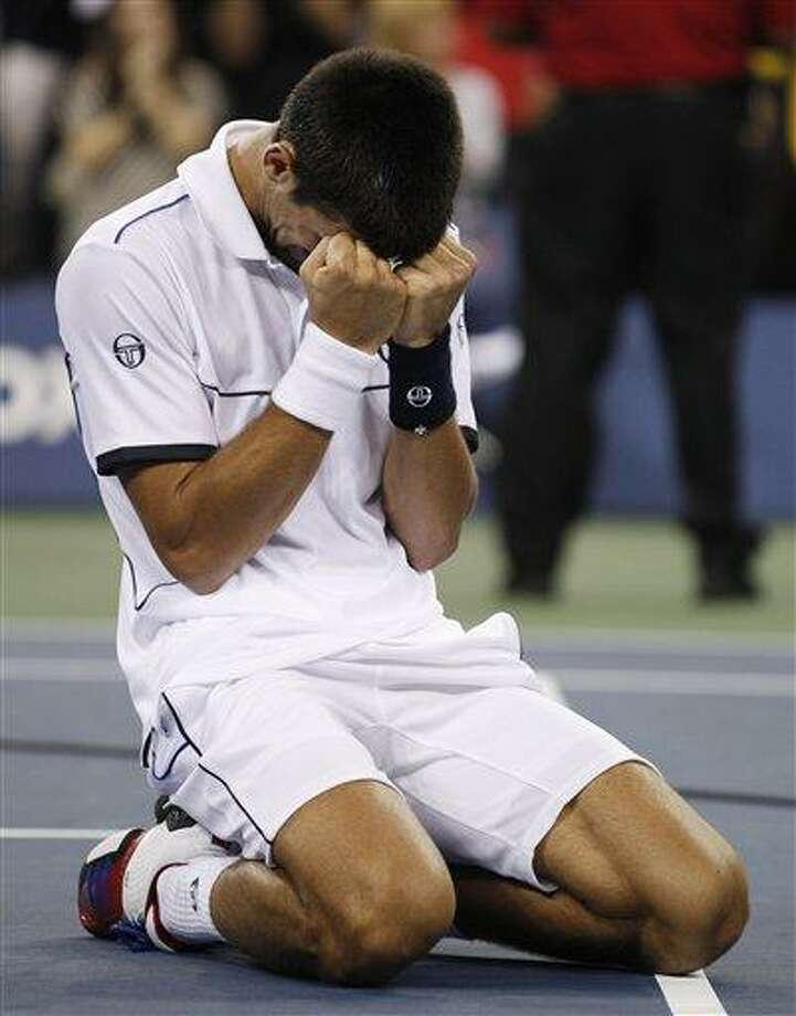 Novak Djokovic of Serbia reacts after winning the men's championship match against Rafael Nadal of Spain at the U.S. Open tennis tournament in New York, Monday, Sept. 12, 2011. (AP Photo/Charles Krupa) Photo: AP / AP