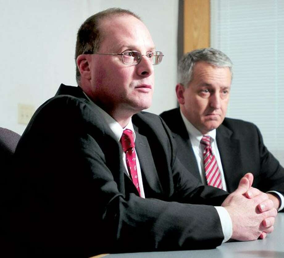 Orange Police Chief Robert Gagne (left) and David Gelios (right), assistant special agent in charge for the FBI, answer questions during a press conference concerning the runaway case of Isabella Oleschuk at the Orange Police Department on Saturday. (Photo by Arnold Gold/New Haven Register)