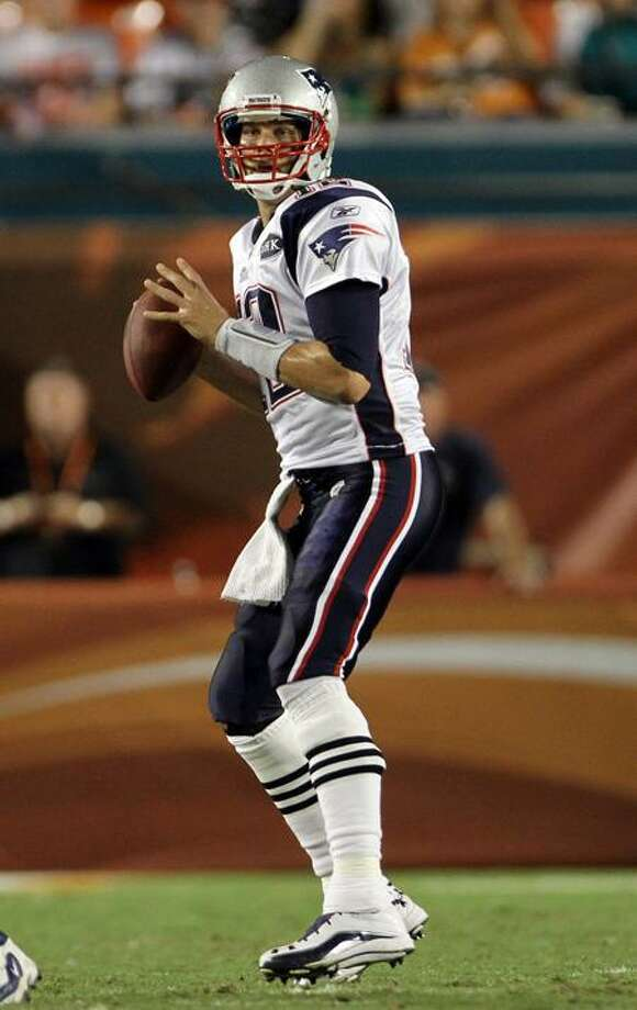 New England Patriots quarterback Tom Brady (12) looks to pass during the first half of an NFL football game against the Miami Dolphins, Monday, Sept. 12, 2011, in Miami. (AP Photo/J. Pat Carter) Photo: AP / AP