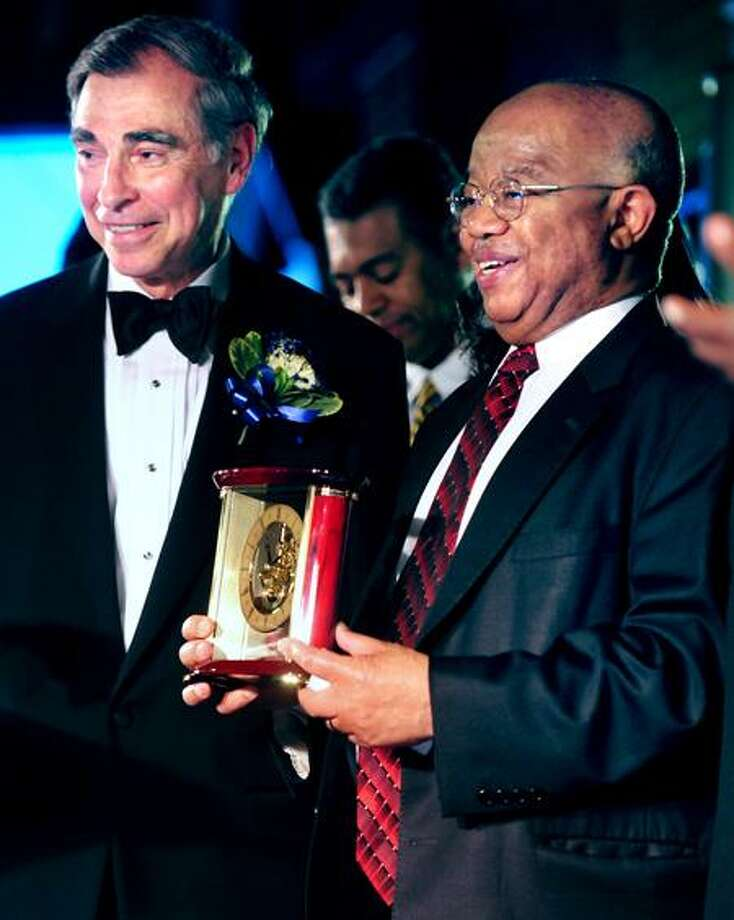 Bruce Alexander, left, vice president of Yale University, presents James P. Comer with the Lifetime Achievement Award at the NAACP Greater New Haven Branch Freedom Fund dinner Saturday at Yale Commons in New Haven.