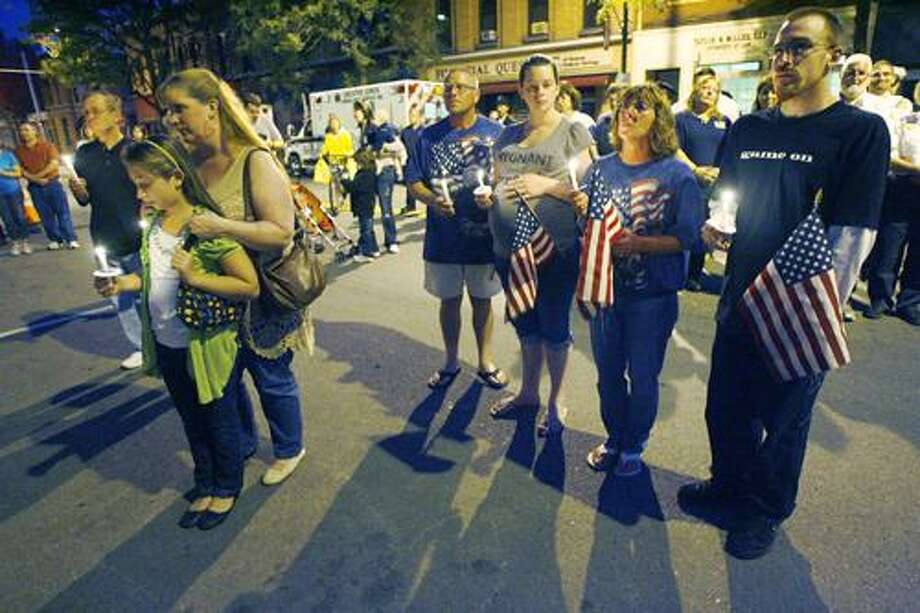 Photo by JOHN HAEGER (Twitter.com/OneidaPhoto) People take part in a 9/11 remembrance in the village of Canastota on Sunday, Sept. 11, 2011.
