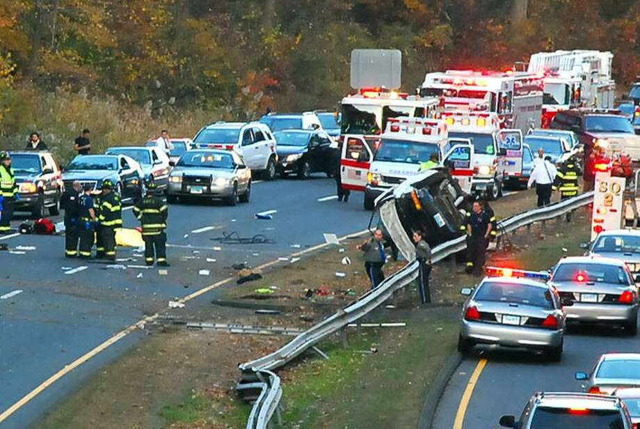 A vechicle lies flipped over in the southbound lane of the Merritt Parkway about a quarter of a mile from the Woodin St overpass in Hamden (camera view from the overpass looking toward North Haven). Robert Martens/ for the Register