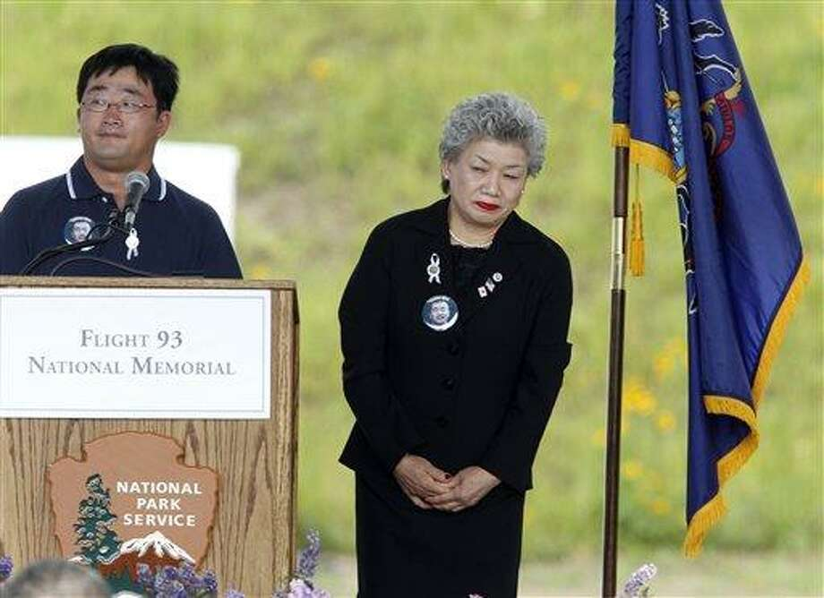 Loved ones of Toshiya Kuge, a Japanese student who died in the crash of Flight 93 participate in the reading of the names of the deceased during memorial services near the crash site of Flight 93 in Shanksville, Pa. Sunday Sept. 11, 2011.  (AP Photo/Gene J. Puskar) Photo: ASSOCIATED PRESS / AP2011