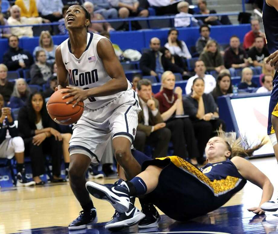 Connecticut's Tiffany Hayes looks for a shot past Pace's Margo Hackett in the second half of an exhibition NCAA college basketball game, Wednesday, Nov. 9, 2011, in Hartford, Conn. Connecticut defeated Pace 85-35. (AP Photo/Bob Child) Photo: AP / FRE 170410 AP