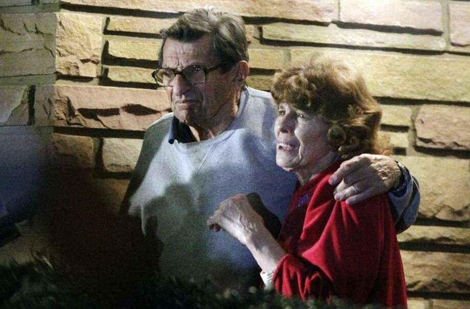 Penn State football coach Joe Paterno, left, and his wife, Susan, stand on their porch to thank supporters gathered outside their home after John P. Surma, chairman and chief executive officer of the Penn State Board of Trustees, announced the firing of Paterno and university president Graham Spanier amid the growing furor over how the school handled sex abuse allegations against an assistant coach, Wednesday, Nov. 9, 2011, in State College, Pa. (AP Photo/Gene J. Puskar) Photo: AP / AP