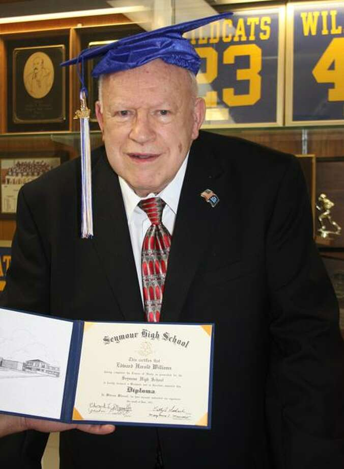 Seymour World War II veteran Edward Williams finally holds his high school diploma. Jean Falbo-Sosnovich/Register photos
