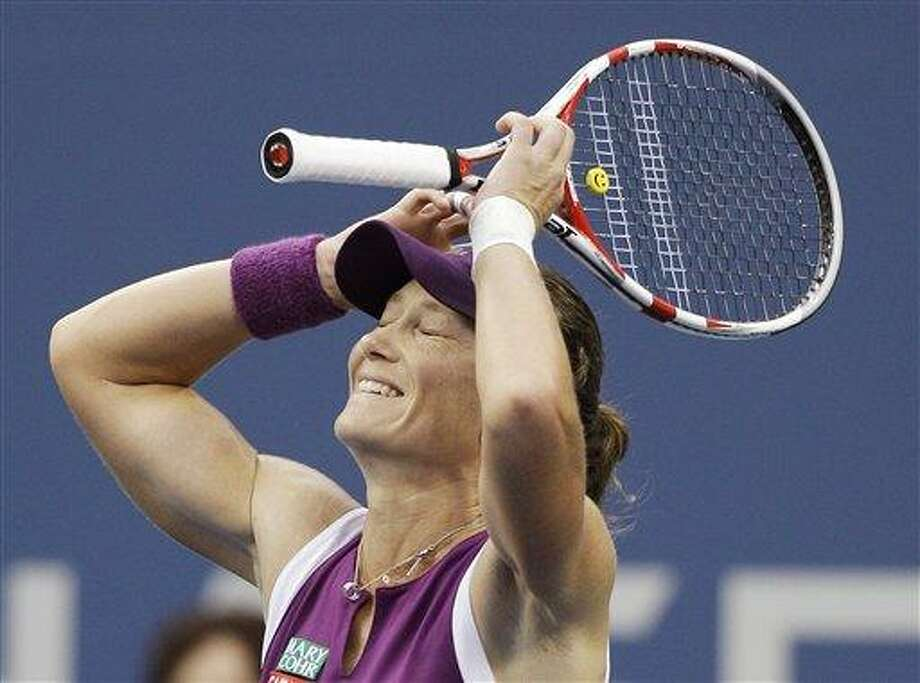 Samantha Stosur of Australia reacts after winning the women's championship match against Serena Williams at the U.S. Open tennis tournament in New York, Sunday, Sept. 11, 2011. (AP Photo/Matt Slocum) Photo: ASSOCIATED PRESS / AP2011