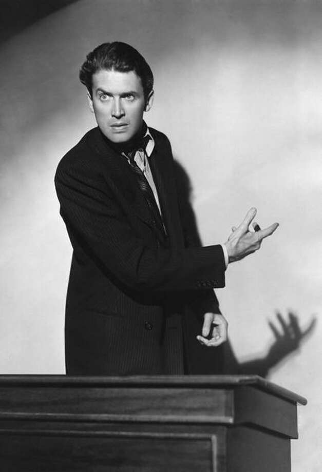 1939:  American film star James Stewart (1908 - 1997) presents his case eloquently from the witness box in a scene from the political satire 'Mr Smith Goes to Washington', directed by Frank Capra for Columbia.  (Photo by Hulton Archive/Getty Images) Photo: Getty Images / Hulton Archive