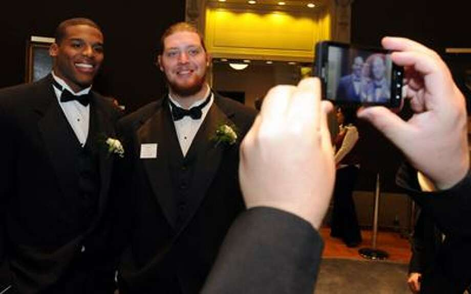 Yale University was the site of the annual Walter Camp dinner highlighting the Walter Camp Award winners and All-America team including Cam Newton left and teammate Lee Ziemba right. Photo by Mara Lavitt/New Haven Register1/15/11