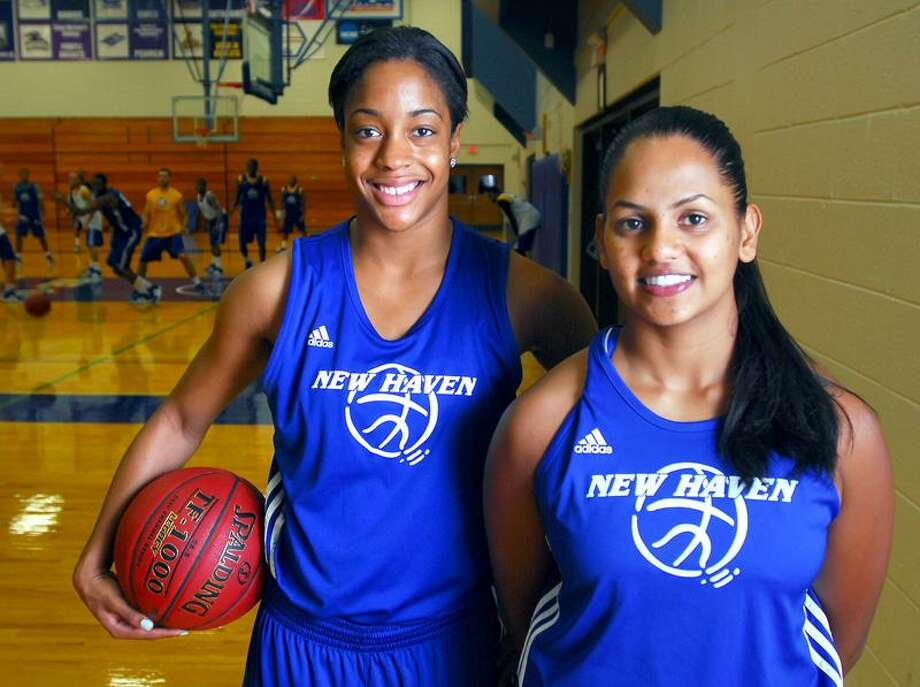 University of New Haven girls' basketball captains Ayana Duncanson (left) and Nikita Reddy (right) are photographed at Charger Gymnasium in West Haven on 11/9/2011.Photo by Arnold Gold/New Haven Register    AG0429F