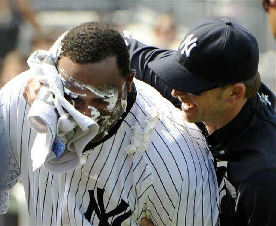 New York Yankees winning pitcher CC Sabathia, left, is hit with a towel full of shaving cream by A. J. Burnett after the Yankees defeated the Tampa Bay Rays 1-0 in a baseball game Sunday, July 10, 2011, at Yankee Stadium in New York. (AP Photo/Bill Kostroun) Photo: AP / FR51951 AP