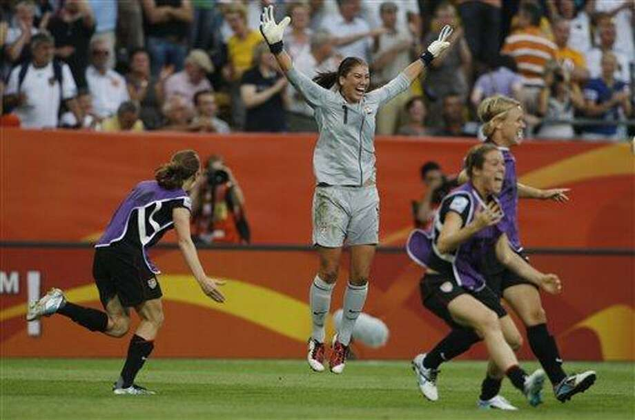 United States goalkeeper Hope Solo jumps in celebration after the US won in a penalty shootout the quarterfinal match between Brazil and the United States at the Women's Soccer World Cup in Dresden, Germany, Sunday, July 10, 2011. (AP Photo/Petr David Josek) Photo: AP / AP