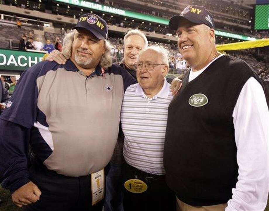 New York Jets head coach Rex Ryan, right, poses with his father Buddy Ryan and his brother Dallas Cowboys defensive coordinator Rob Ryan, left, before an NFL football game Sunday, Sept. 11, 2011,  in East Rutherford, N.J. (AP Photo/Julio Cortez) Photo: AP / AP