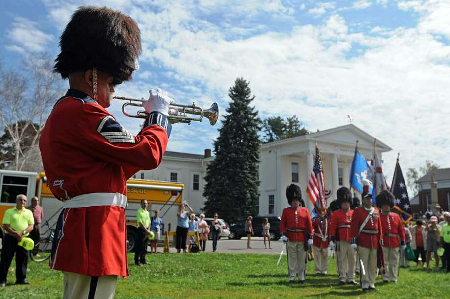"Branford--Staff Sgt. Paddy Flynn of the 2nd Company Governors Foot Guard plays ""Taps"" during the 10th anniversary 9/11 remembrance on the Branford green organized by the Branford Rotary.   Peter Casolino/New Haven Register9/11/11"
