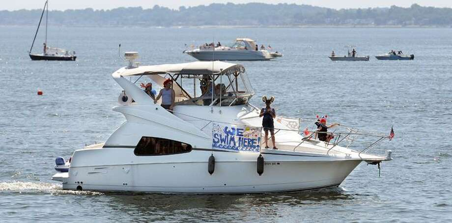 New Haven boaters, residents and politicians come out to protest proposed dumping of Bridgeport Harbor dredgings into New Haven Harbor.  Mara Lavitt/Register  7/10/11