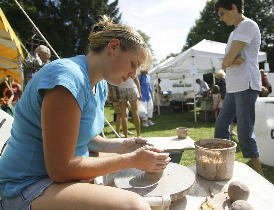 "Dispatch Staff Photo by JOHN HAEGER <a href=""http://twitter.com/oneidaphoto"">twitter.com/oneidaphoto</a> Potter Laurie Turner demonstrates her skill during the 47th annual Craft Days at the Madison County Historical  Society in the city of Oneida on Saturday Sept. 10, 2011."