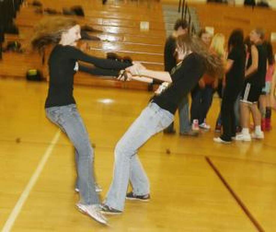 Dispatch Staff Photo by JOHN HAEGER Ally Netzband, 14, and Kally DeGroat, 14, spin as they dance at the SVCS Lock-In in Friday.