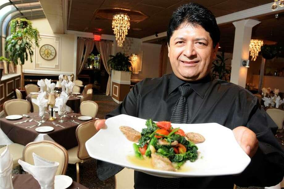 Peter Hvizdak/Register photo: Edgar Ortiz, chef and owner of La Luna Ristorante in Branford, prepared his Broccoli di Rabe con Salsiccia.