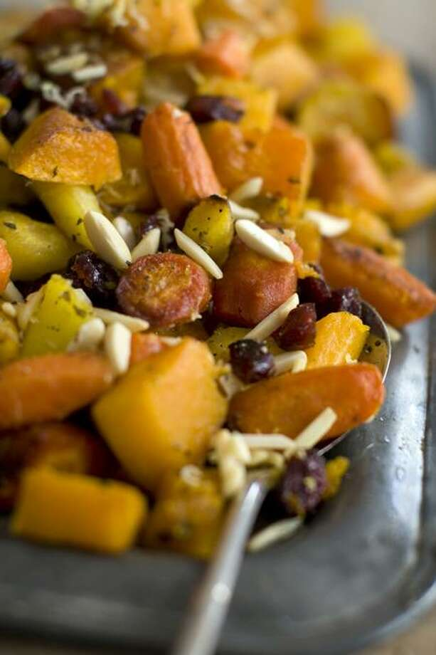 Matthew Mead/Associated Press photo: Roasted Squash With Almonds and Cranberries Photo: AP / AP2011