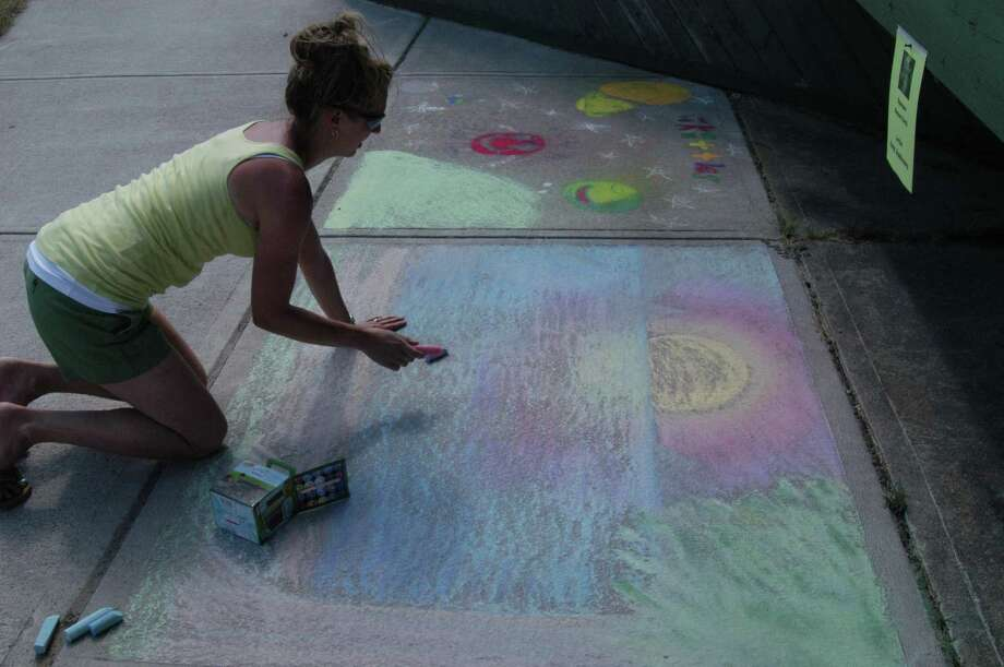 Dispatch Photo by Caitlin Traynor Second place winner and Camden High School Art Teacher Amy Andrews puts the finishing touches on her chalked sunset scene at Chalk the Walk in Sylvan Beach Saturday.