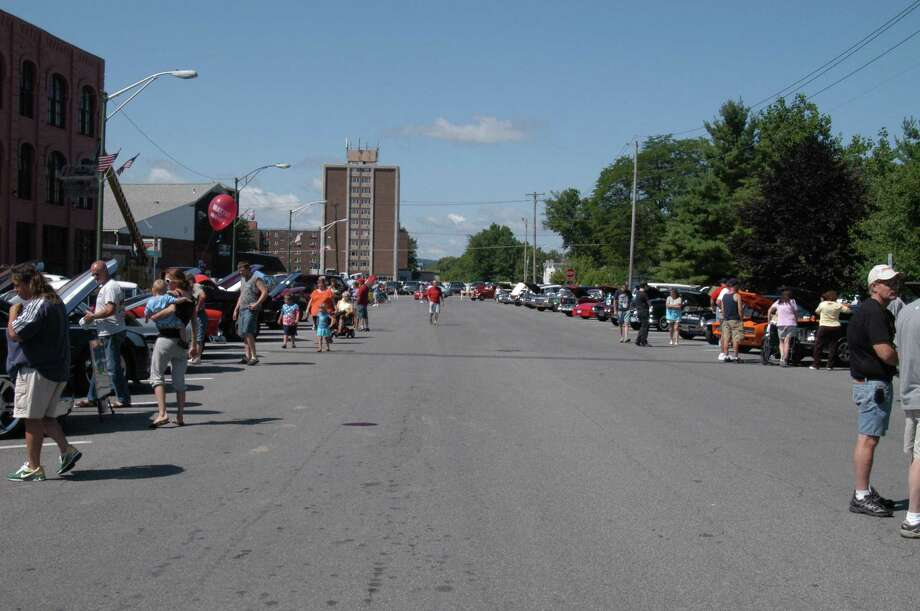 Dispatch Photo by Kurt Wanfried People look at vehicles entered into Summer Fest's car show Saturday in downtown Oneida.