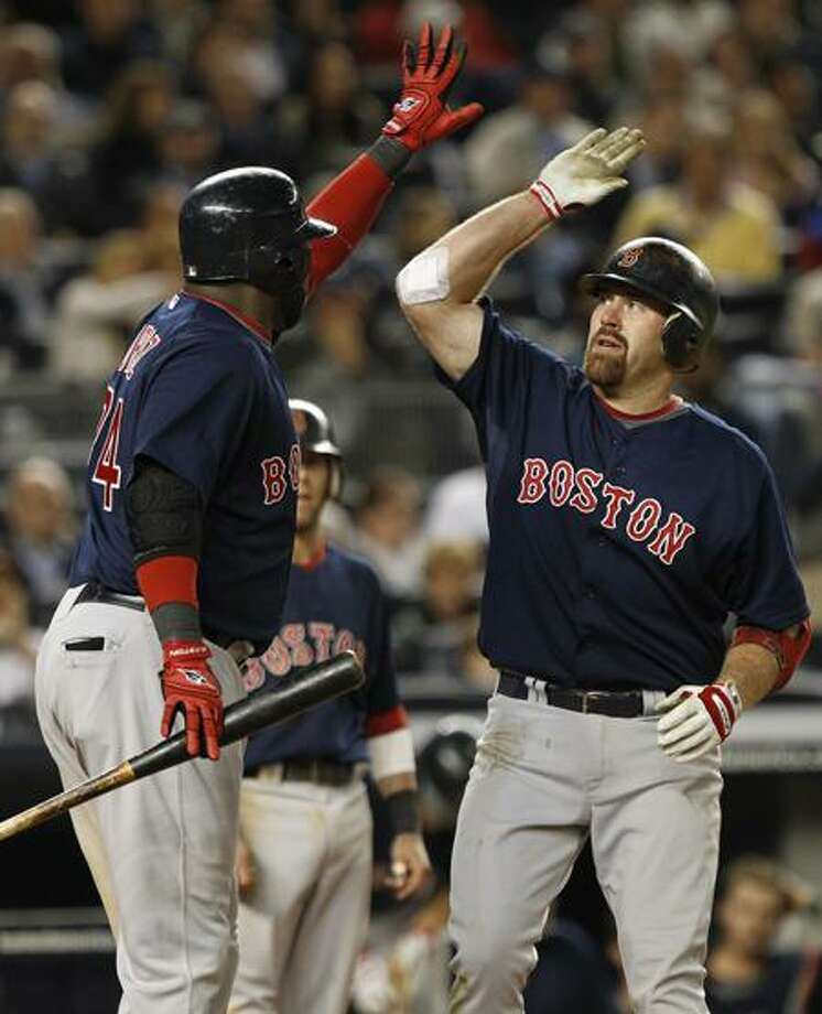 Boston Red Sox's Kevin Youkilis, right, celebrates with teammate David Ortiz after hitting a two-run home run during the seventh inning of a baseball game against the New York Yankees Friday, May 13, 2011, at Yankee Stadium in New York. (AP Photo/Frank Franklin II) Photo: AP / AP2011