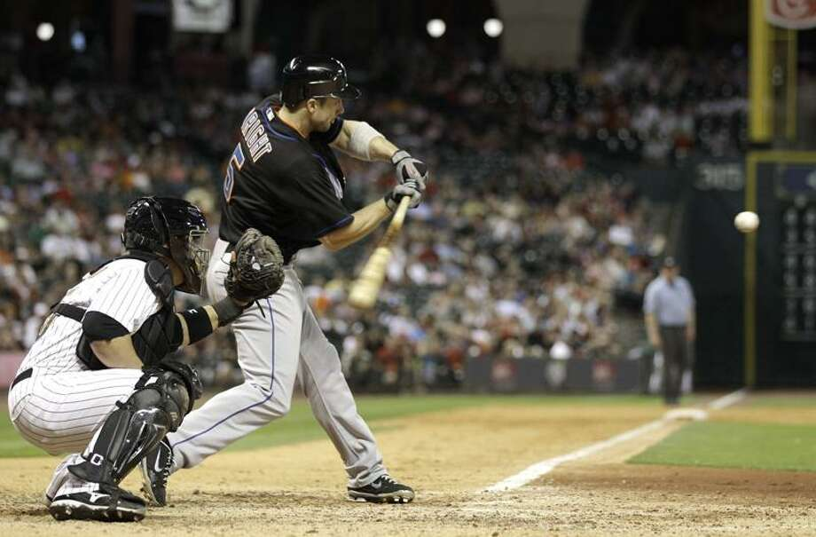 New York Mets' David Wright (5) hits a two-run home run as Houston Astros catcher Humberto Quintero, left, reaches for the pitch during the eighth inning of a baseball game Friday, May 13, 2011, in Houston. (AP Photo/David J. Phillip) Photo: AP / AP