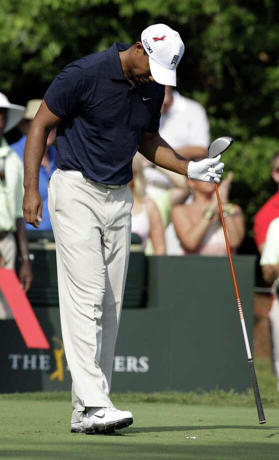 Tiger Woods walks slowly after hitting on the seventh tee during the first round of The Players Championship golf tournament Thursday May 12, 2011 in Ponte Vedra Beach, Fla. Woods withdrew after nine holes because of leg injuries. (AP Photo/Chris O'Meara) Photo: ASSOCIATED PRESS / AP2011