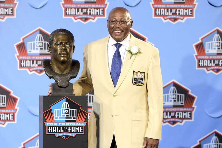 Floyd Little poses with his bust after enshrinement in the Pro Football Hall of Fame in Canton, Ohio Saturday, Aug. 7, 2010. (AP Photo/Mark Duncan) Photo: AP / AP2010