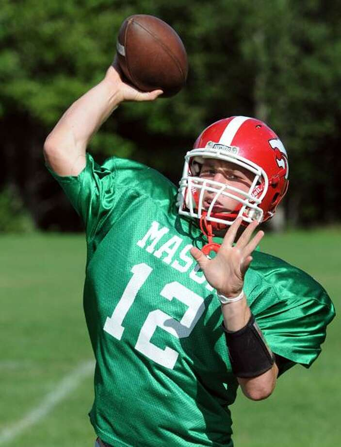 Masuk quarterback Casey Cochran hopes to lead the Panthers to a second straight Class L state championship.   Peter Casolino/New Haven Register