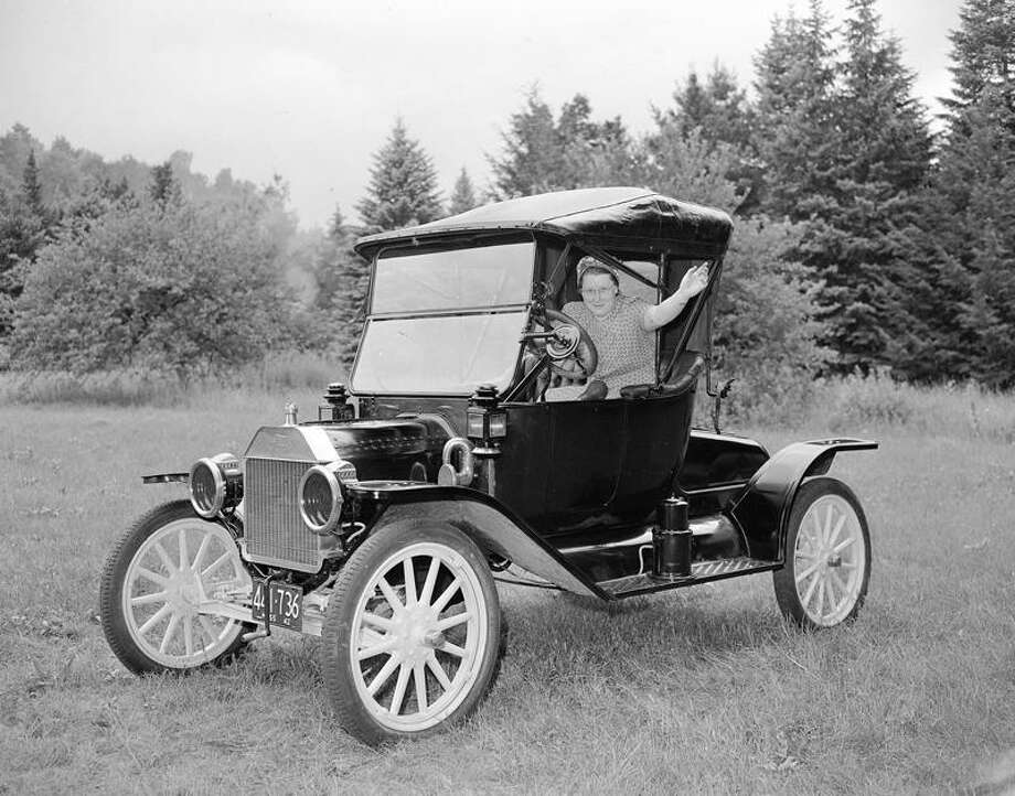 Mrs. Mildred C. Reniff of Ashfield, Mass, waves good-bye as she starts a test flight in her vintage 1914 Model T. Ford, August 4, 1944. Mrs. Reniff heeded advice of Federal Agencies to make cars last as long as possible and had it put in tip top shape. Tank on running Board mixes Carbide and water to form gas for headlights. (AP Photo) Photo: ASSOCIATED PRESS / AP1944