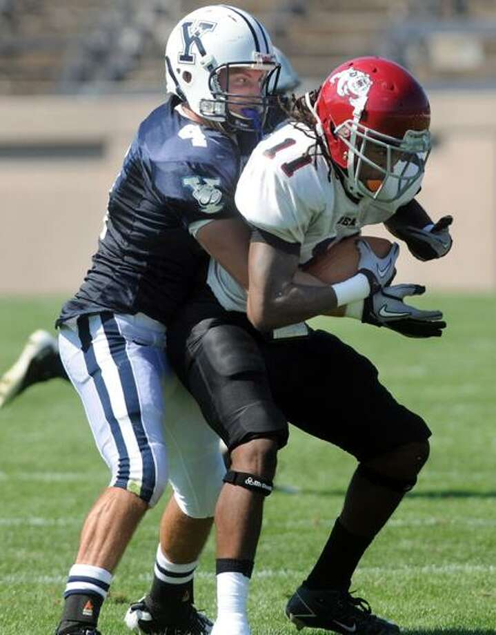 Dean College at Yale football scrimmage, first half:  Yale defensive back Dawson Halliday stopping Dean wide receiver Malcolm Bagley. Photo by Mara Lavitt/New Haven Register9/10/11