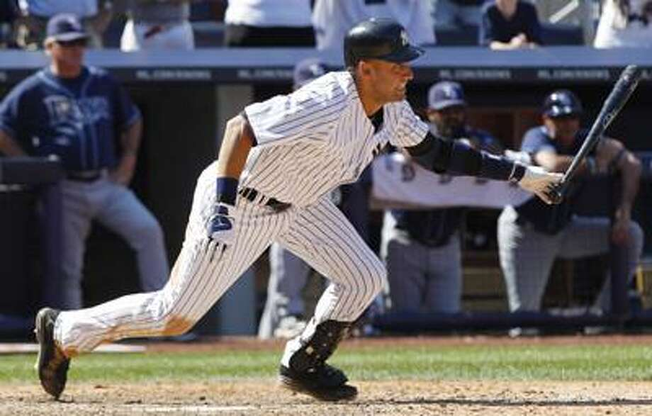 New York Yankees' Derek Jeter follows through on an hits an RBI single during the eighth inning of a baseball game against the Tampa Bay Rays Saturday, July 9, 2011, at Yankee Stadium in New York. The Yankees won the game 5-4. (AP Photo/Frank Franklin II) Photo: AP / AP
