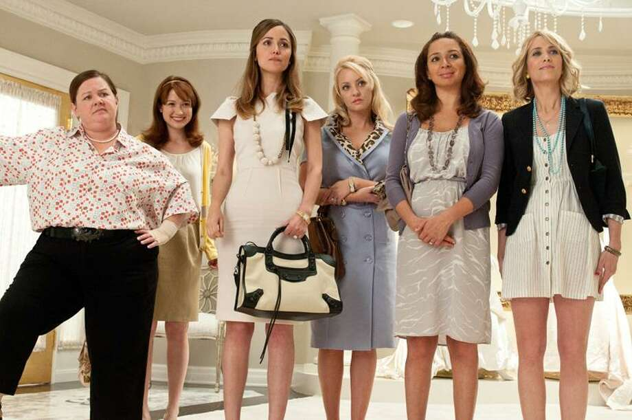 "In this publicity image released by Universal Pictures, from left, Melissa McCarthy, Ellie Kemper, Rose Byrne, Wendi McLendon-Covey, Maya Rudolph and Kristen Wiig are shown in a scene from ""Bridesmaids."" (AP Photo/Universal Pictures, Suzanne Hanover) Photo: ASSOCIATED PRESS / AP2010"
