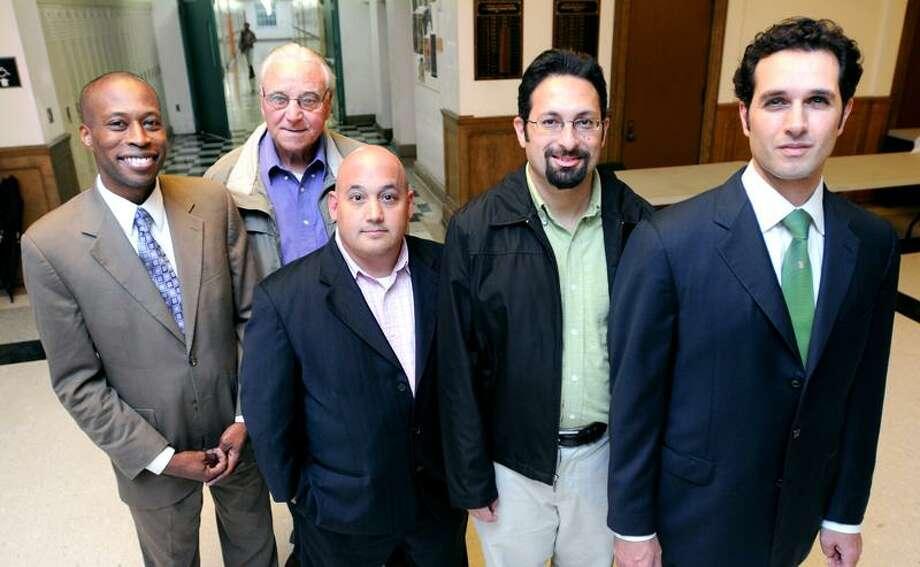 Left to right - Hamden Mayor Scott Jackson, former football coach Ron Carbone, Howard Hornreich, Adam Sendroff and Michael D'Agostino are photographed inside Hamden High School  on 9/6/2011.Photo by Arnold Gold/New Haven Register    AG0423C