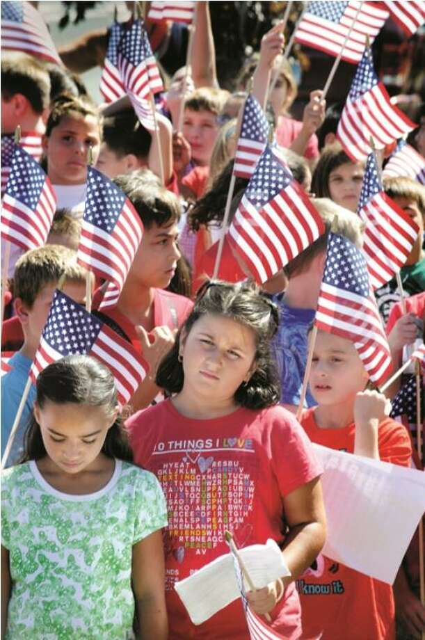 EAST HAVEN--Students from Tuttle School in East Haven gather for a 911 rememberance ceremony at Town Hall. Melanie Stengel  (Edit)