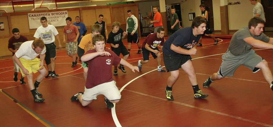 "Dispatch Staff Photo by JOHN HAEGER <a href=""http://twitter.com/oneidaphoto"">twitter.com/oneidaphoto</a> Canastota wrestlers work out on the opening day of the 2011-2012 season on Mon. Nov. 7, 2011 in Canastota."
