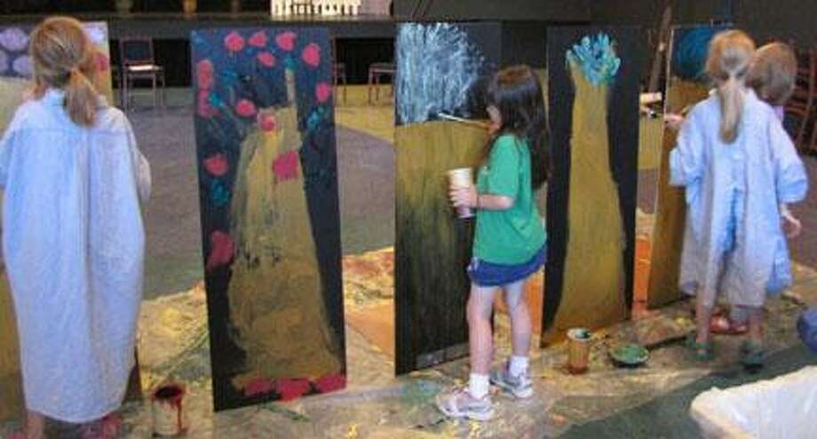 "Submitted Photo Lexi Lapp, Lynne Thielke, Emily Holm and Arielle Nemes paint their set for the one-act ""A Kittens Adventure."""