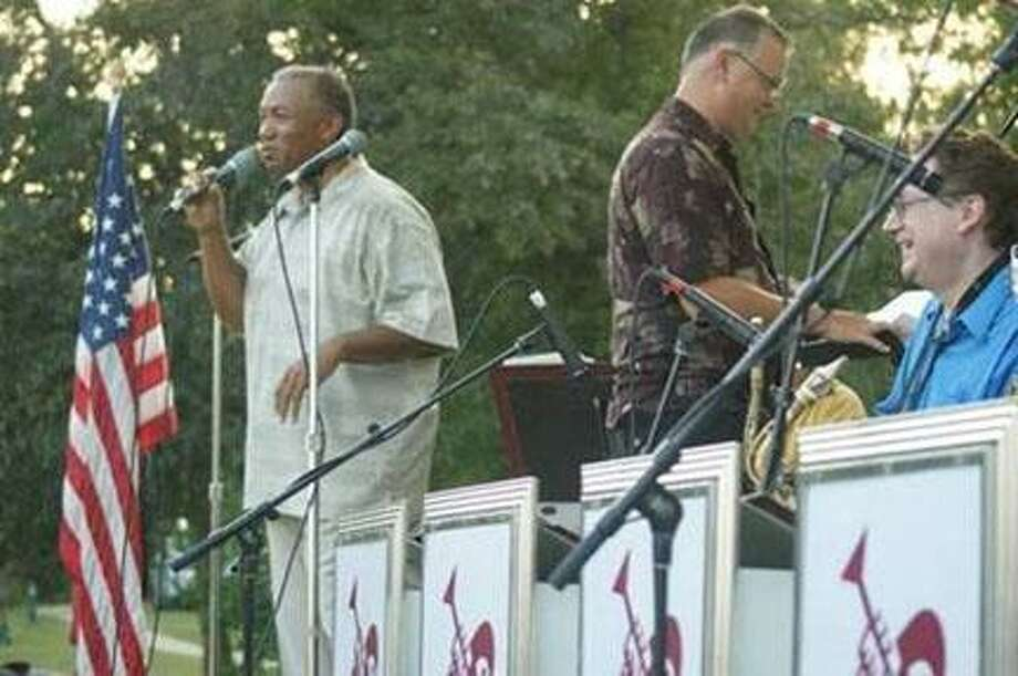Submitted Photo by JOHN HERRRonnie Leigh sings with the CNY jazz orchestra at the ÒFayetteville JazzÓ concert in Beard Park in July, 2010.