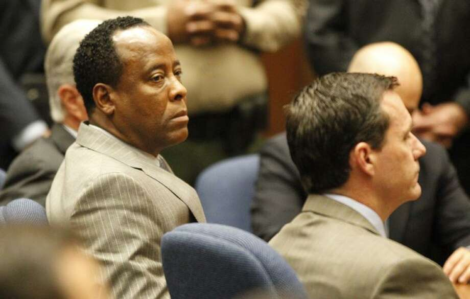 Dr. Conrad Murray listens as the jury returns with a guilty verdict in his involuntary manslaughter trial Monday in a Los Angeles courtroom.  Associated Press Photo: AP / AP2011