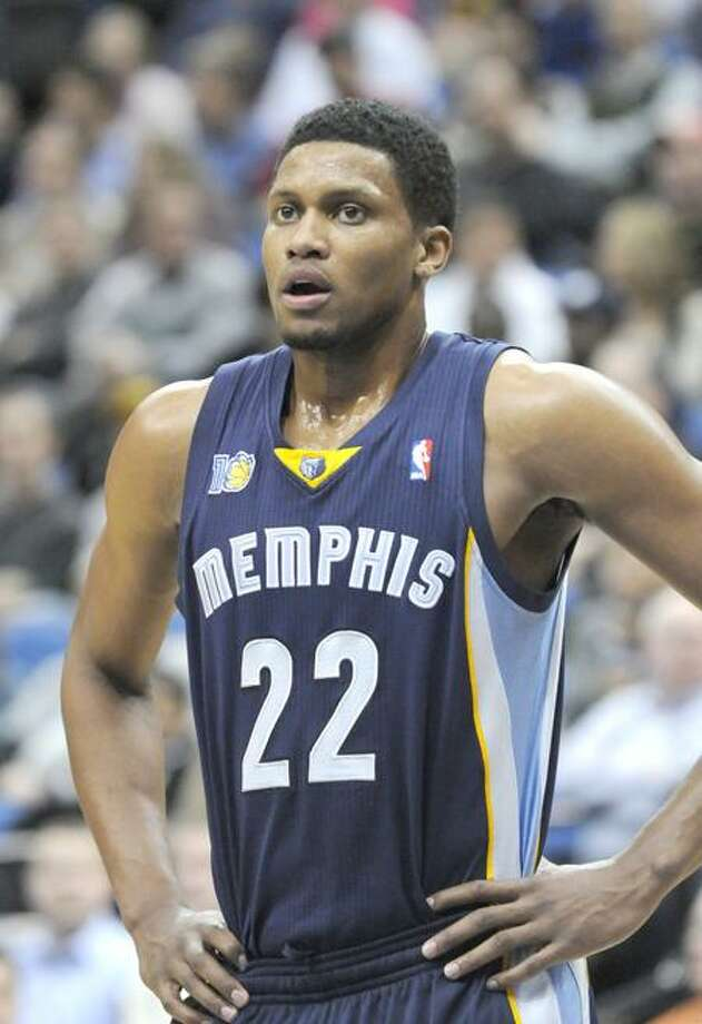 FILE - This Feb. 2, 2011, file photo shows Memphis Grizzlies' Rudy Gay during the second half of an NBA basketball game against Minnesota,  in Minneapolis.  Gay needs surgery on his injured left shoulder and will miss the rest of the season. The Grizzlies announced Tuesday, March 22, 2011,  the team's physician Fred Azar and orthopedic surgeon James Andrews have recommended surgery for Gay's partially dislocated shoulder. (AP Photo/Jim Mone, File) Photo: AP / AP2011