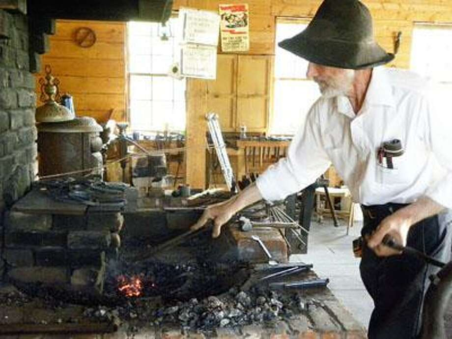 SUBMITTED PHOTO A blacksmith plies his wares at the annual Chittenango Landing Canal Boat Museum's Canal Fest.