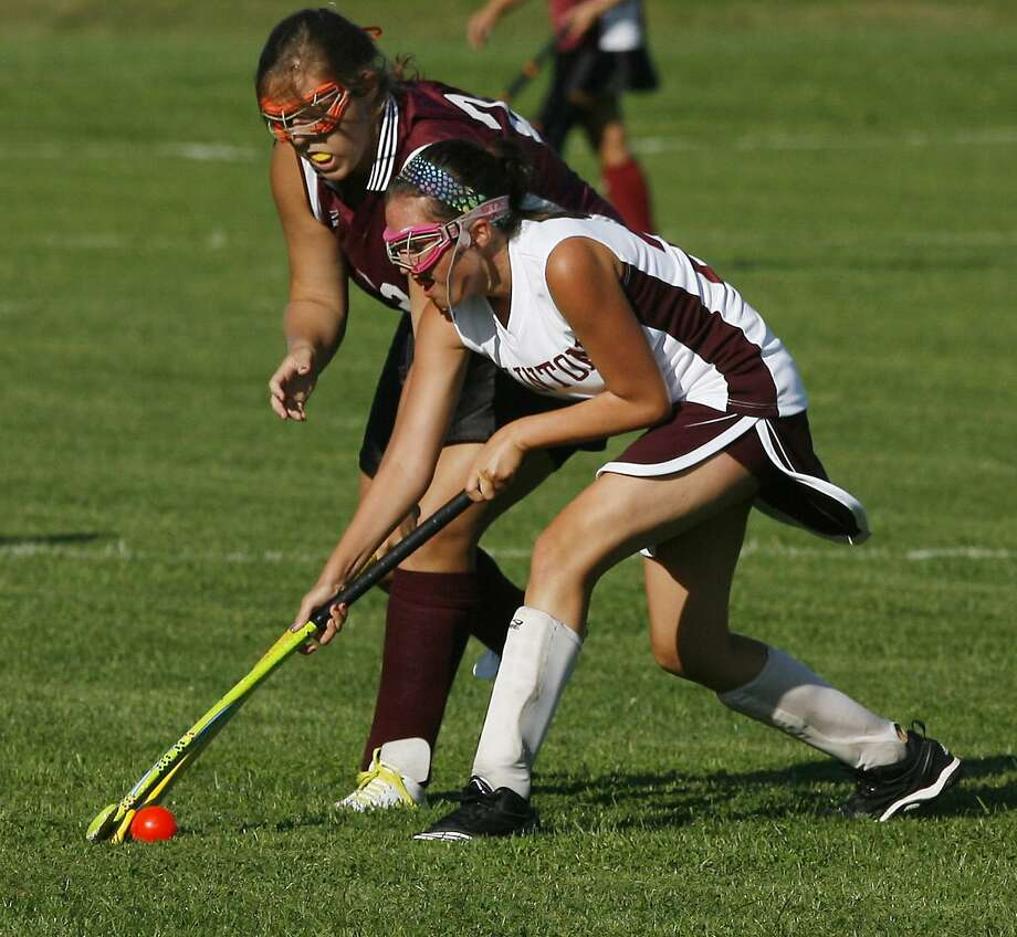 """Dispatch Staff Photo by JOHN HAEGER<a href=""""http://twitter.com/oneidaphoto"""">twitter.com/oneidaphoto</a>Canastota's Shea Foster (22) and Clinton's Anna Femia (20) work for control of the ball in the first half of the match in Clinton on Friday, Sept. 9, 2011."""