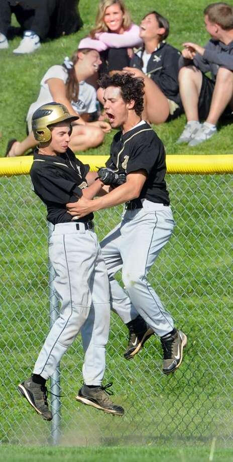 Law's Dave DeRubeis, left, and Joe Bloszko celebrate after tying the game against Foran in the seventh inning on Thursday. (Melanie Stengel/Register)