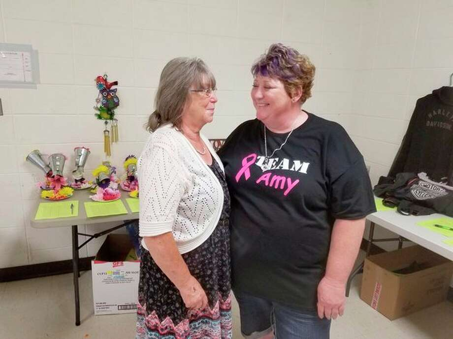 Amy Miehlke, right, and her mother, Connie Doane, stand together at the June 18 benefit at the Mills Community Center.