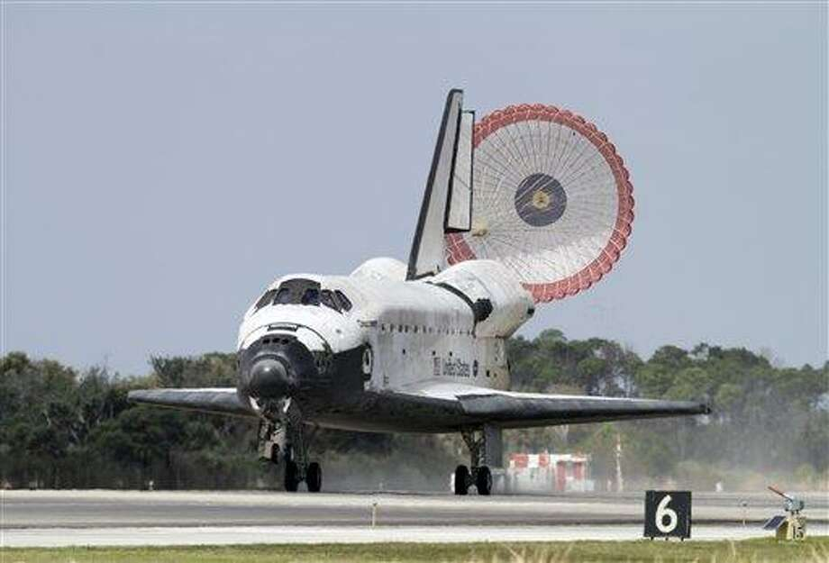 Space shuttle Discovery lands at the Kennedy Space Center in Cape Canaveral, Fla., Wednesday, March 9, 2011. Discovery ended its career as the world's most flown spaceship Wednesday, returning from orbit for the last time and taking off in a new direction as a museum piece. (AP Photo/Terry Renna) Photo: AP / FR60642 AP